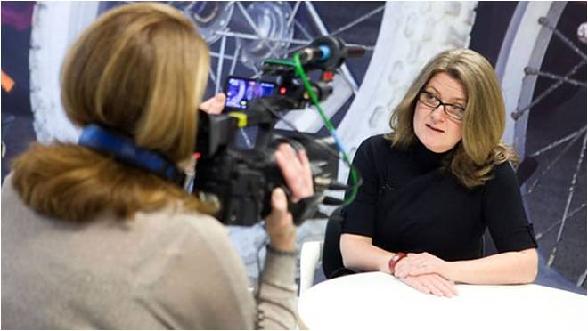 A woman being interviewed on camera