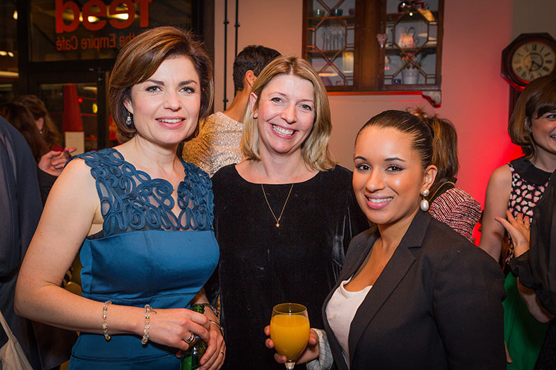 Three women smiling at the camera