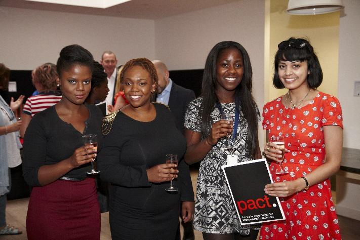 Four women smiling for camera